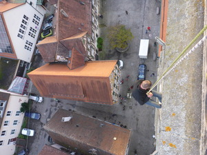 Abseiling from church spire